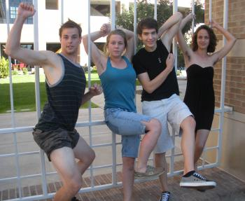 four students posing on campus