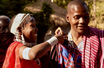 people of the Maasai tribe smiling and dressing for a celebration