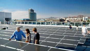 professor with students viewing solar panels on ASU rooftop