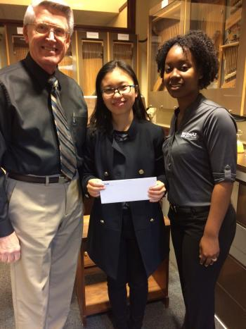 student holding carillon scholarship