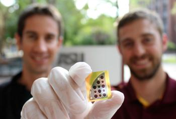 Mathieu Boccard (left) and Jacob Becker (right) pose with a 20 percent CdTe solar cell developed in tandem by Yong-Hang Zhang's and Zachary Holman's laboratories