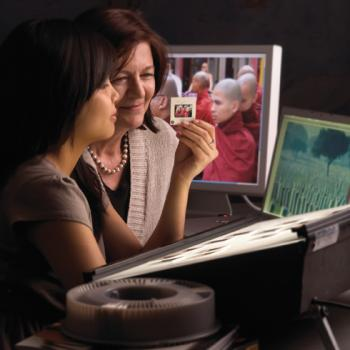 two women looking at photos