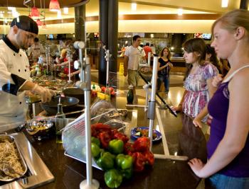two students having food made for them at a college dining facility