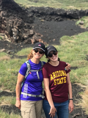 Principal Lecturer Chiara Dal Martello, left, stands with undergraduate student Bianca Navia at the top of Mt. Etna in Sicily, Italy, in June 2018.