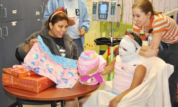 Child life specialists work with a young patient.