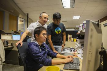 Professor Huan Liu works with his students in the Data Mining and Machine Learning Lab