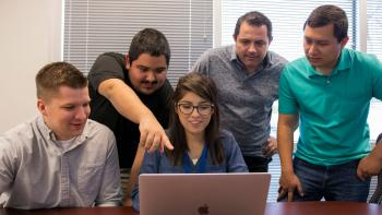 McKesson Vice President of Cybersecurity Operations and Services Paul Black (second from right) hired on the first class of interns from Arizona State University's Ira A. Fulton Schools of Engineering and W. P. Carey School of Business in summer 2017.
