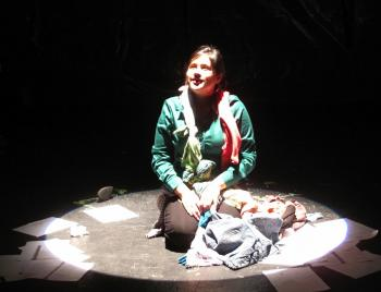 "actress on stage performing in the play ""Women of Ciudad Juarez"""
