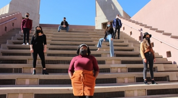 The student cast of the ASU School of Music, Dance and Theatre's Color Cabaret stand at varying points on a staircase