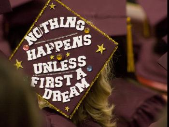 graduation cap that says: Nothing happens unless first a dream