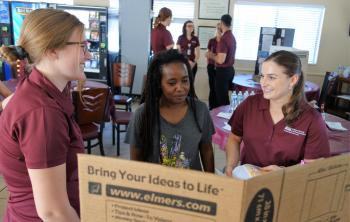 ASU nursing students talk with a Crossroads resident during a Health Fair