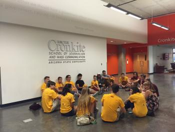 students sitting on floor in a circle
