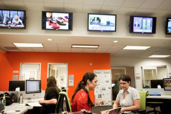 students working in a newsroom at the ASU Cronkite School