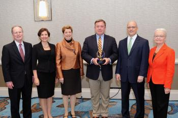 ASU President Michael Crow standing with ACE leaders