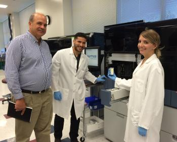 ASU alumnus Dan Kolk with two lab assistants at Hologic