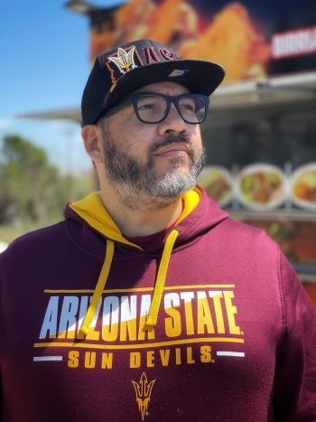 David Lew proudly shows off his ASU gear.