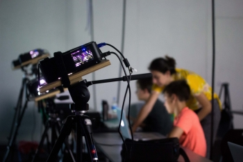 Middle students and professors doing projection mapping