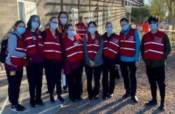 Edson College students pose before starting their shift at a COVID-19 vaccination site in the East Valley