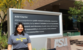 Dina De Leon poses in front of the ASU charter
