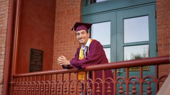 ASU grad Dominic Frattura in his cap and gown at Old Main