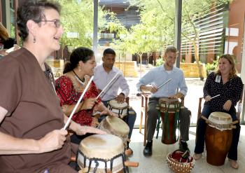 ASU College of Integrative Sciences and Arts students, faculty, alums treat cancer survivors to drum circle demo