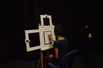 Photo of artist drawing