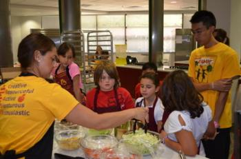 ASU nutrition student performing cooking demonstration for children