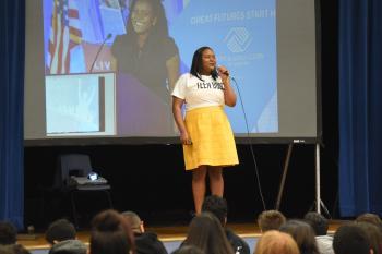 Mona Dixon presenting on stage