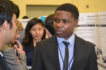ASU student talking to teammate at CGI U 2015