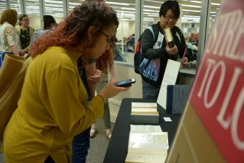 Students view signed copies of Martin Luther King Jr. Strength to Love Stride Toward Freedom