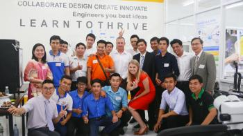 Photo of large group of people posing at the launch of the Maker Innovation Space in Ho Chi Minh City, Vietnam