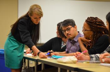Dr. Erika Camacho working with students in her classroom