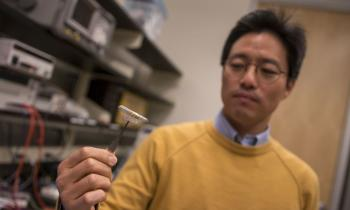 Junseok Chae holds a prototype of a wireless, fully passive neural recorder.