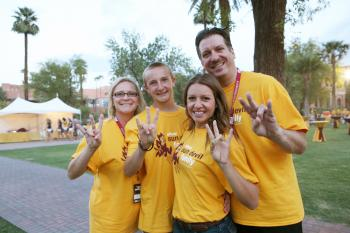 Sun Devil family displaying the pitchfork
