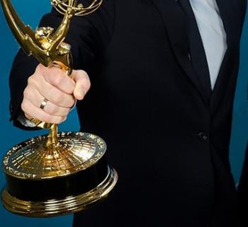 person holding Emmy award