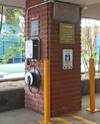 An EV charging station is mounted to a pillar at the Fulton Center garage.