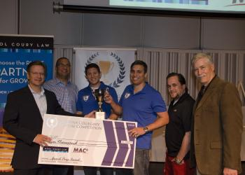 ASU students pose with trophy at startup competition