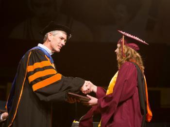 Teagan Adamson receiving master's degree