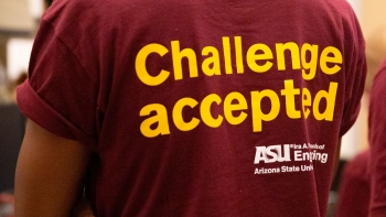 """A student in the Grand Challenges Scholars Program at ASU wears a t-shirt that says """"Challenge Accepted."""""""