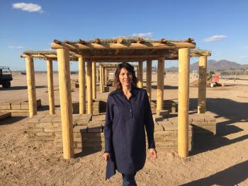 Herberger Institute Professor Wanda Dalla Costa in front of a shade structure she built in Gila River Indian Community.