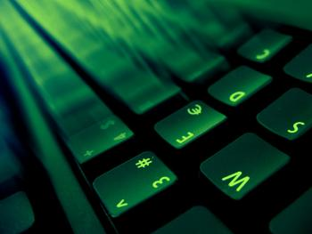 Image of a keyboard lit with green light