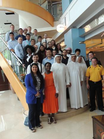 interior group photo of His Excellency, program leaders, and students in Dubai