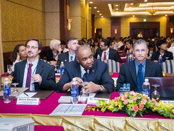 participants seated at a table at the HEEAP conference