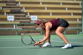 Ilze Hattingh, Sun Devil, crouches on the court while playing women's tennis