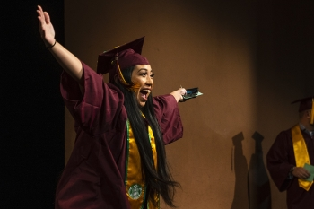 a graduate celebrates at the fall 2019 convocation for the Walter Cronkite School of Journalism and Mass Communication