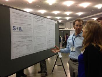 Michael Bernstein with winning poster at AAAS meeting