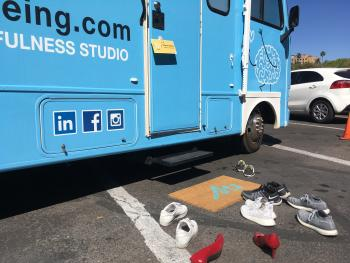 M2 Mobile Mindfulness Truck with shoes outside