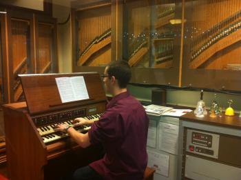 student playing a carillon