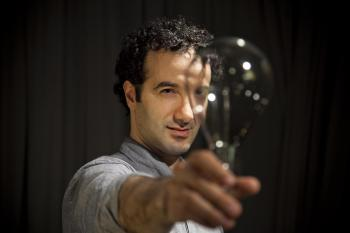 Radiolab creator and host Jad Abumrad holding a lightbulb