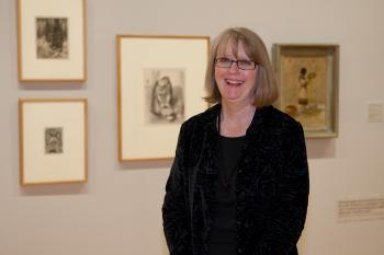 ASU Art Museum Curator of Prints Jean Makin poses in a gallery